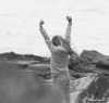 Jaedyn enjoying the energy of the wild sea.